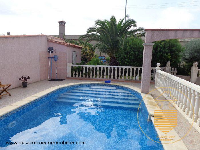Construction cave brique piscine immofavoris for Construction piscine 41